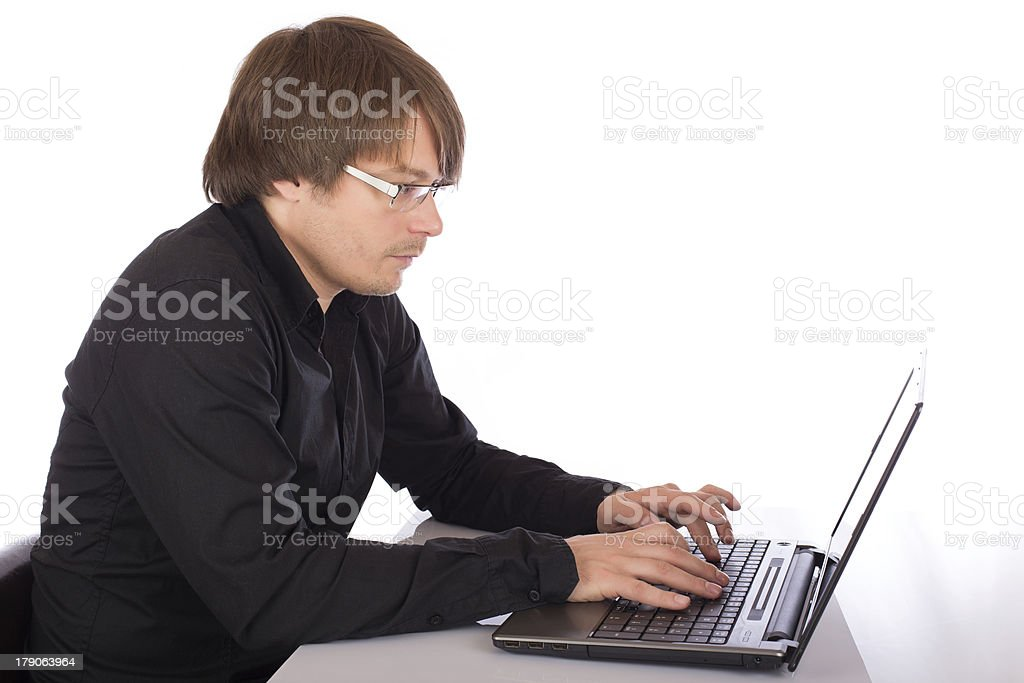 Man working on a laptop royalty-free stock photo