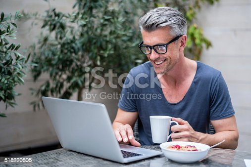 istock Man working on a laptop 518220805