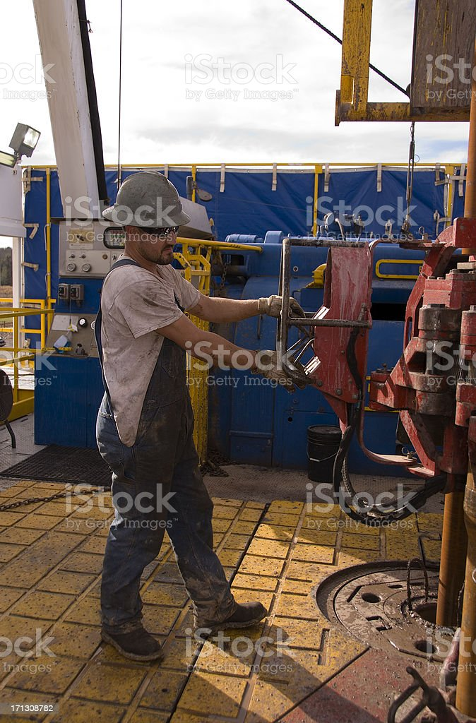 Man working on a Natural Gas Drilling Rig royalty-free stock photo