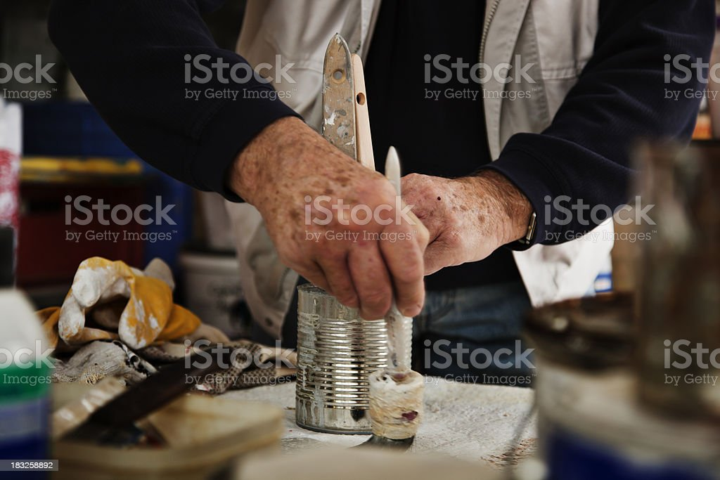 Man Working on a Painting Project royalty-free stock photo