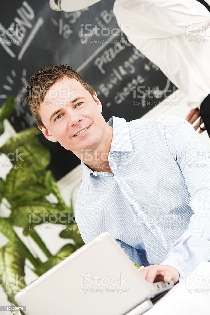 Man Working on Computer at Restaurant Cafe royalty-free stock photo