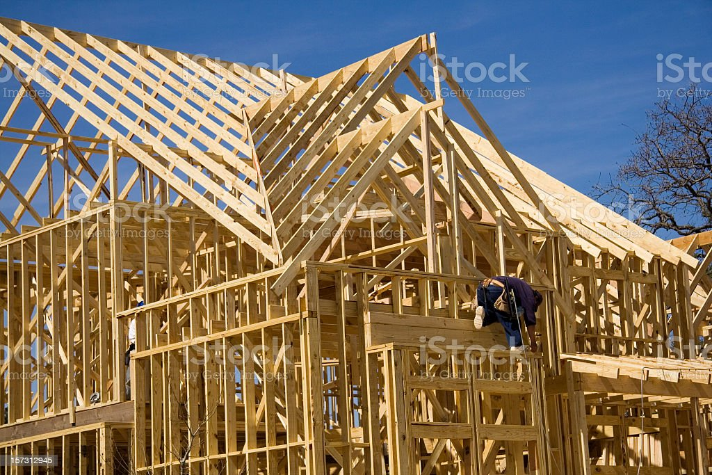 Man working on construction of home royalty-free stock photo