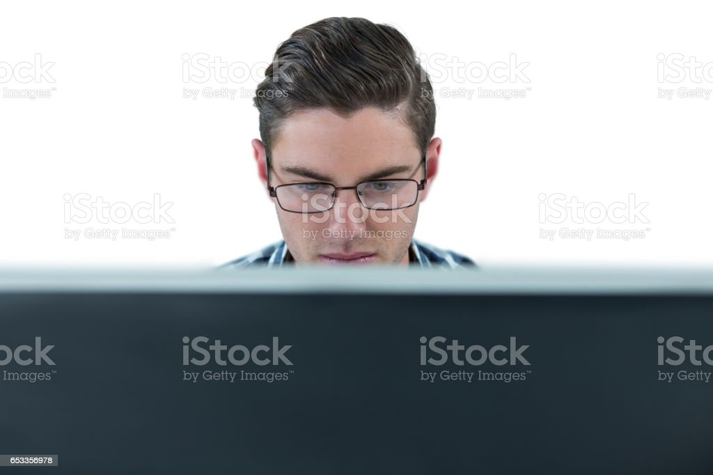 Man working on desktop stock photo