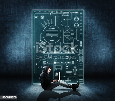 1016971522istockphoto Man working on laptop in front of digital layout. 960695678