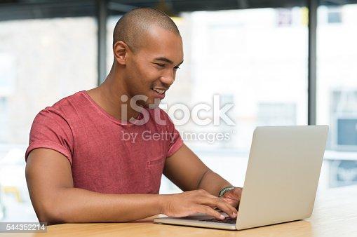 544356862 istock photo Man working on laptop 544352214