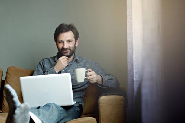 man working on laptop - tamara dragovic stock photos and pictures