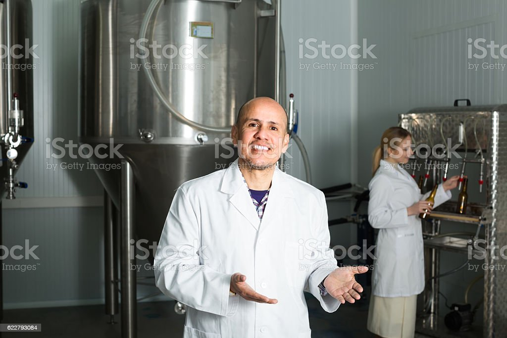 Man working on modern brewery stock photo