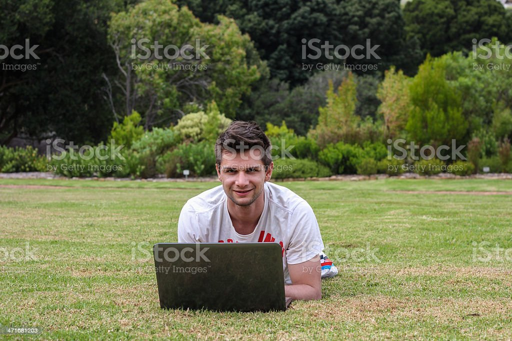 Man working on Notebook outdoors stock photo