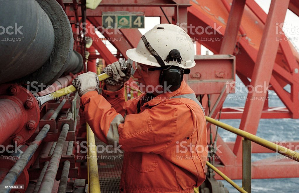 man working on oil rig stock photo