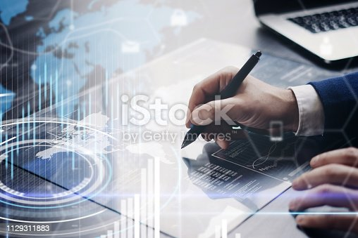 istock Man working on progect using high technology tablet 1129311883