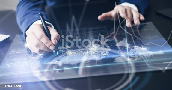 istock Man working on progect using high technology tablet 1129311885