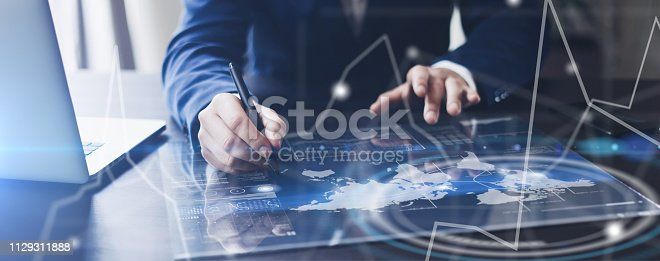 istock Man working on progect using high technology tablet 1129311888