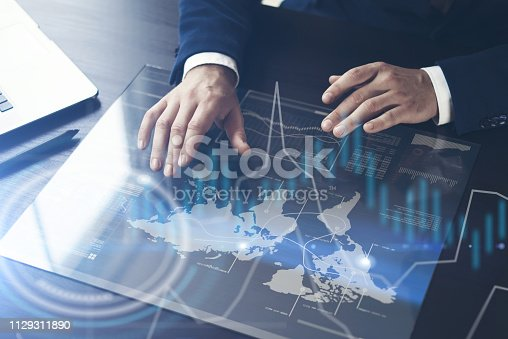 istock Man working on progect using high technology tablet 1129311890