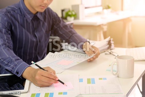 istock Man working on spreadsheet document financial data,Certified public accountant. 1002774154