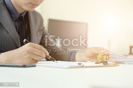 istock Man working on spreadsheet document financial data,Certified public accountant. 1002774758