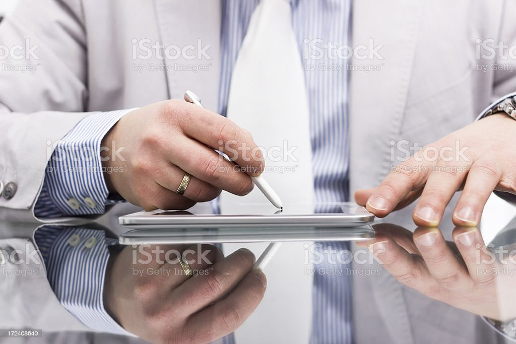 Man working on tablet. stock photo