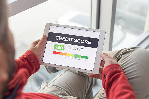 Man working on tablet with Credit Score on screen – Foto