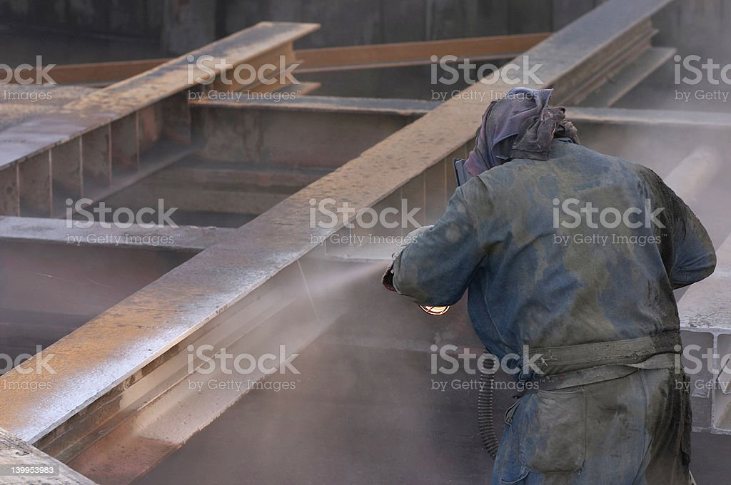 Man working on the metal structure stock photo