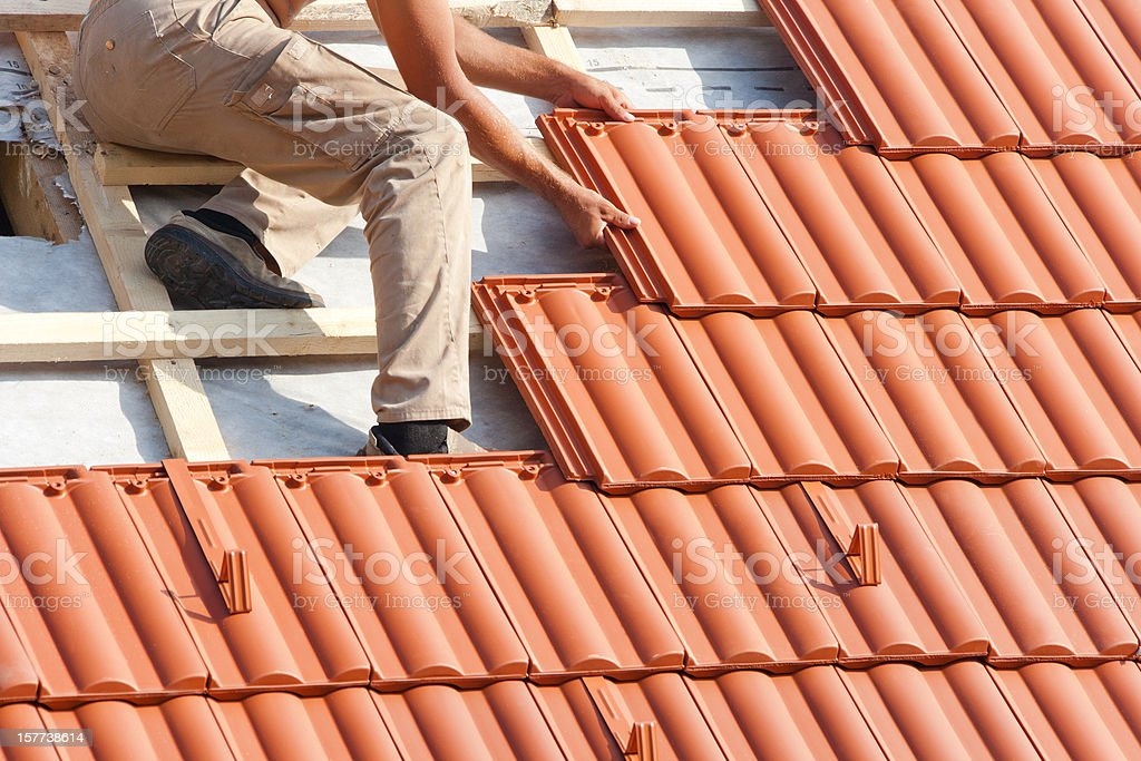 Man working on the roof stock photo