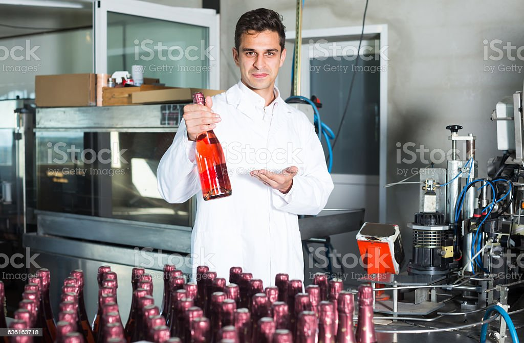 man working on wine production stock photo