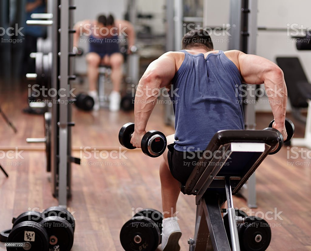 Man working out in front of the mirror stock photo