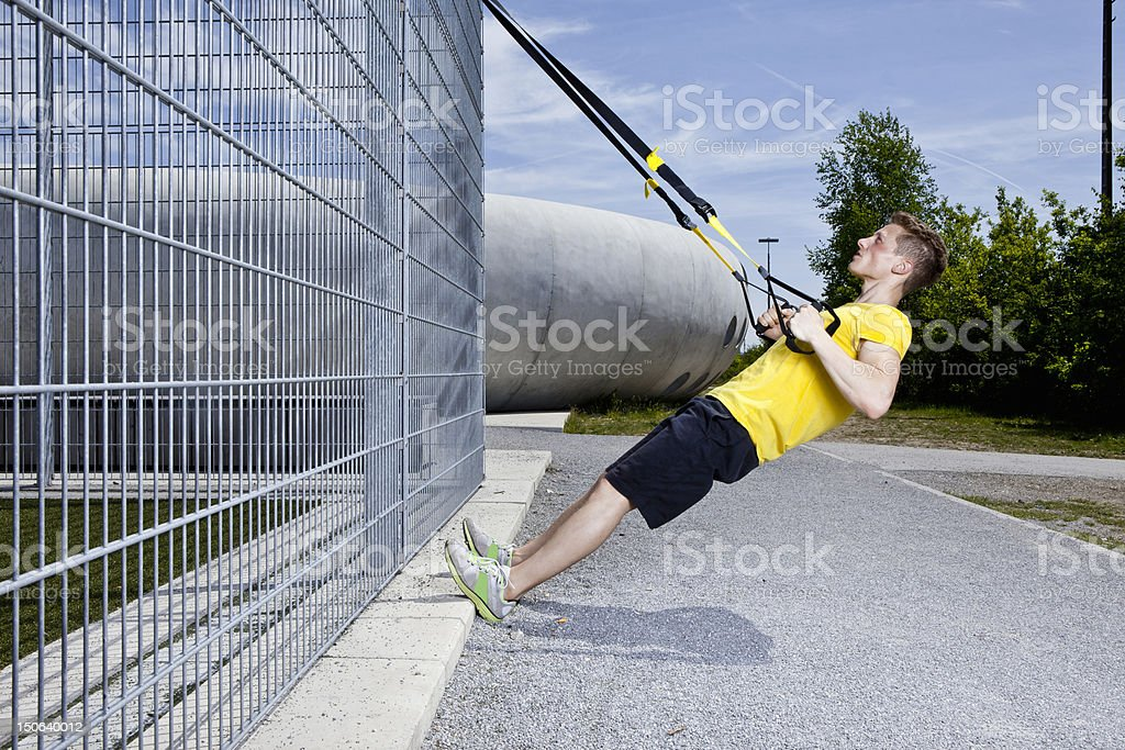 Man working out in industrial area stock photo