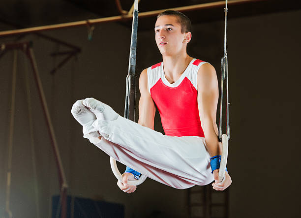 Man working out on gymnastic rings. stock photo