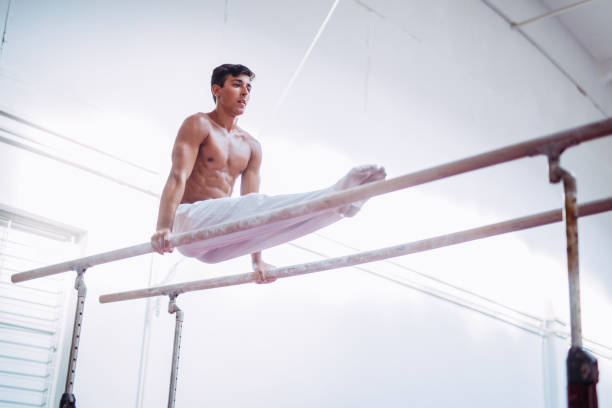 Man working out on parallel bars stock photo