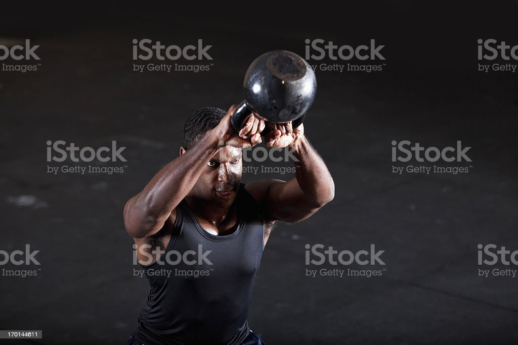 Man working out with kettle bell stock photo