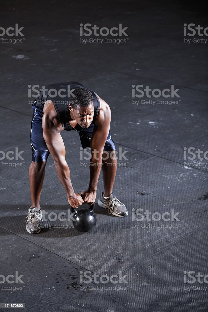Man working out with kettle bell royalty-free stock photo