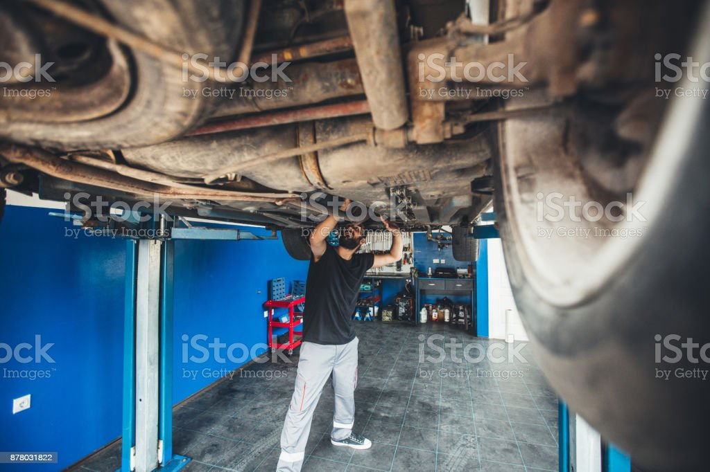 Man working under a vehicle stock photo