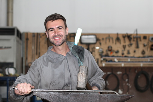 istock Man working with a hammer 928016466