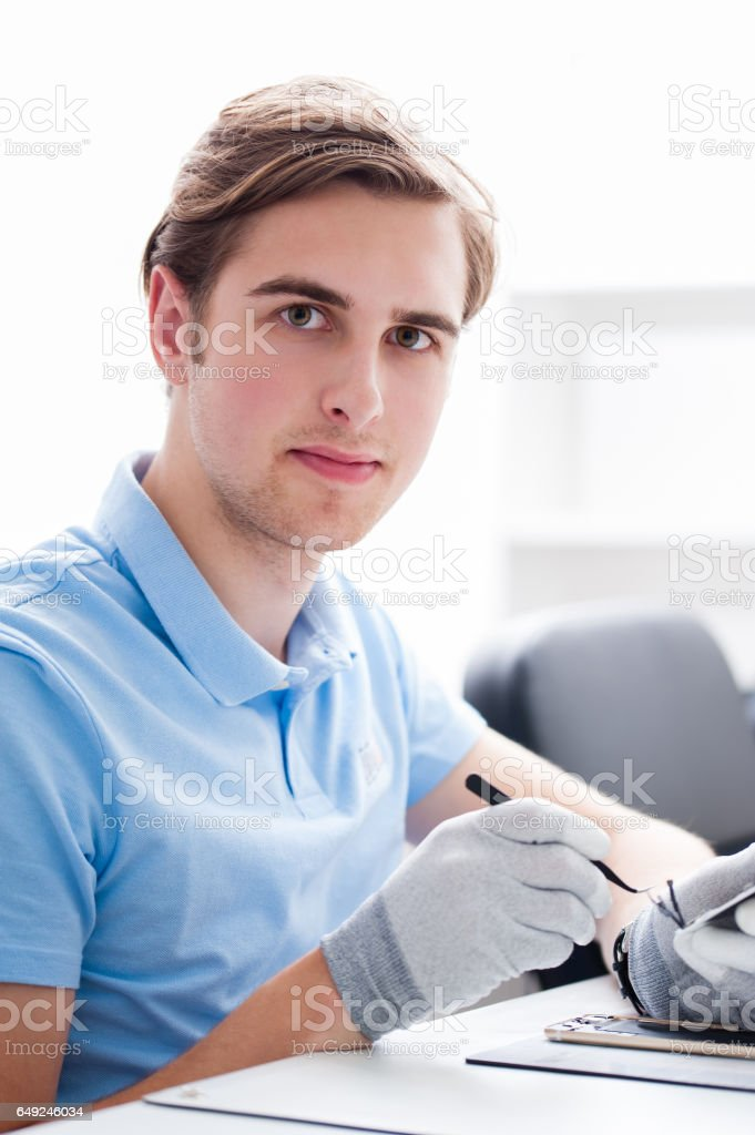 man working with computers and electronics stock photo more
