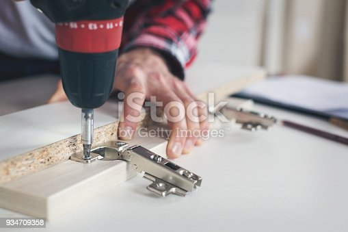 452592895 istock photo Man working with drill 934709358