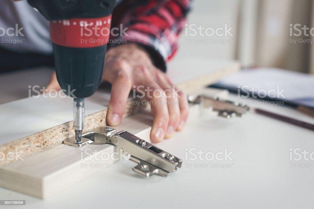 Man working with drill stock photo