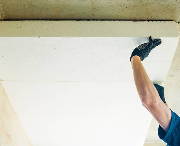 man working with foam plastic stock photo