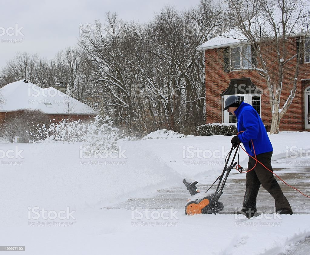 Man Working With his Snowblower stock photo