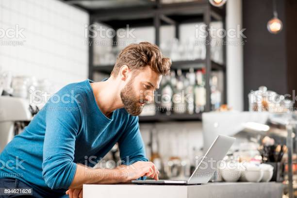 Man working with laptop at the cafe picture id894621626?b=1&k=6&m=894621626&s=612x612&h=2b7q3hld8j2xexqrhnfwexbtkniclkyg3jmqp0bfasq=