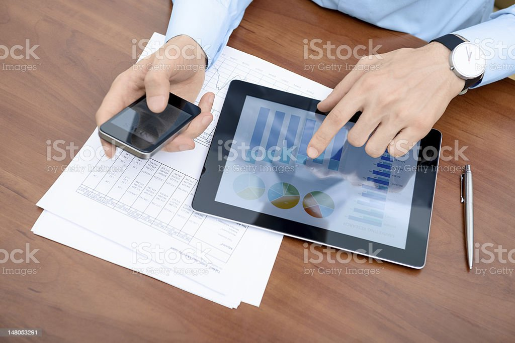 Man working with modern devices stock photo