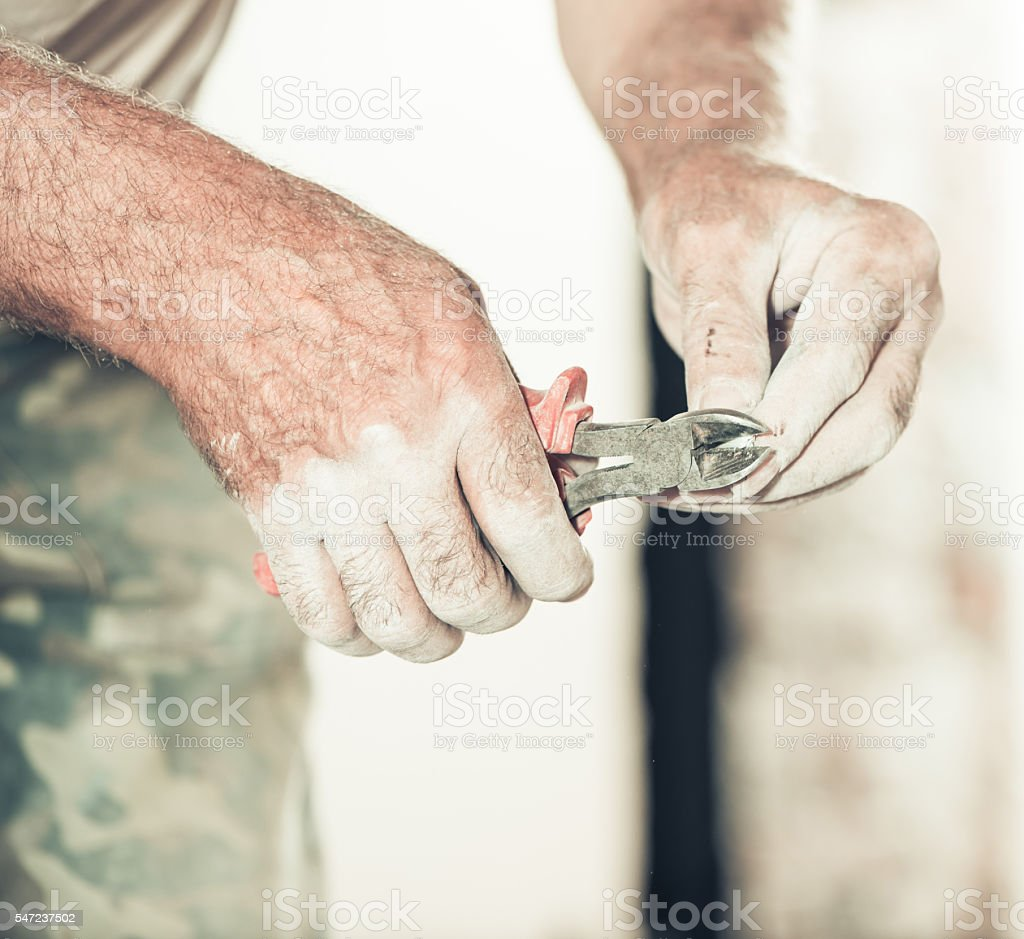 man working with nippers and wire stock photo