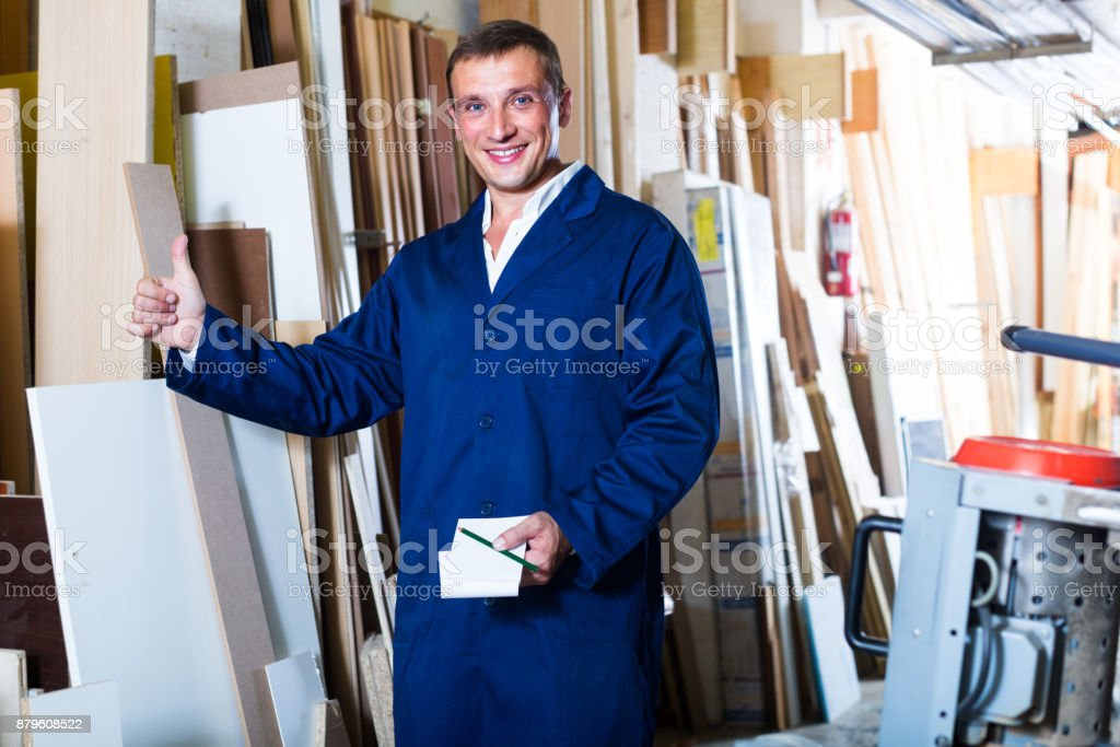 man working with plywood stock photo