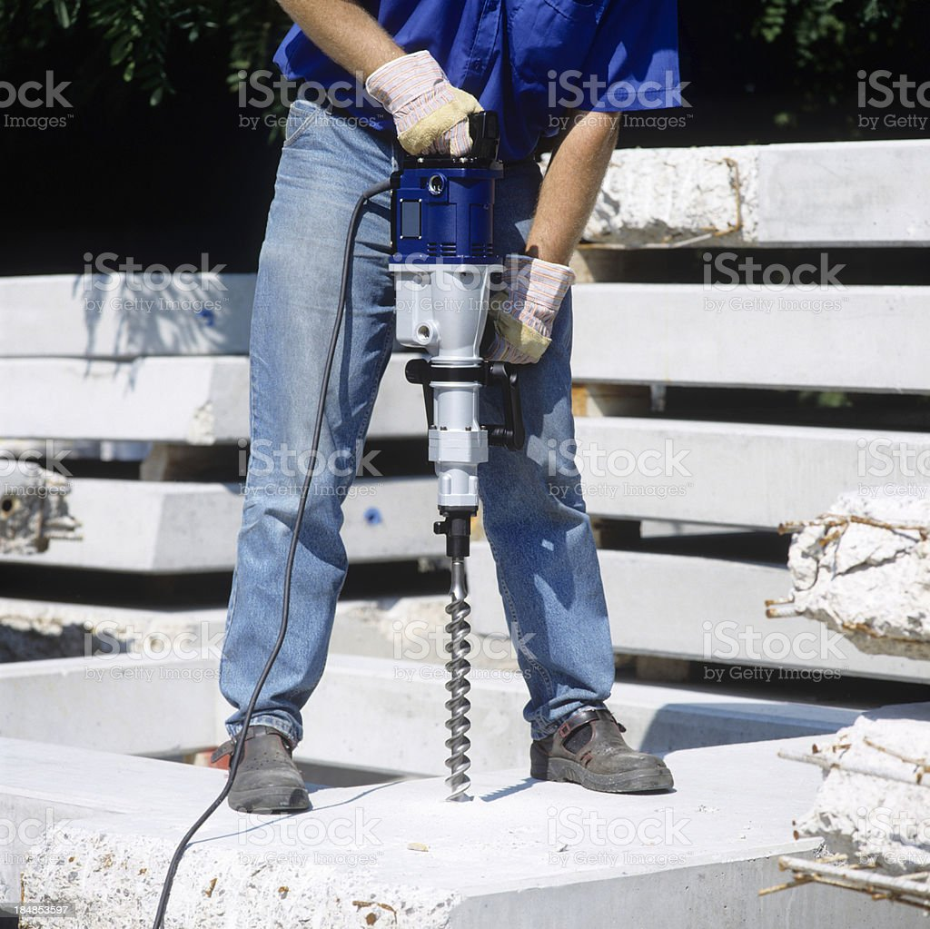 Man working with power drill stock photo