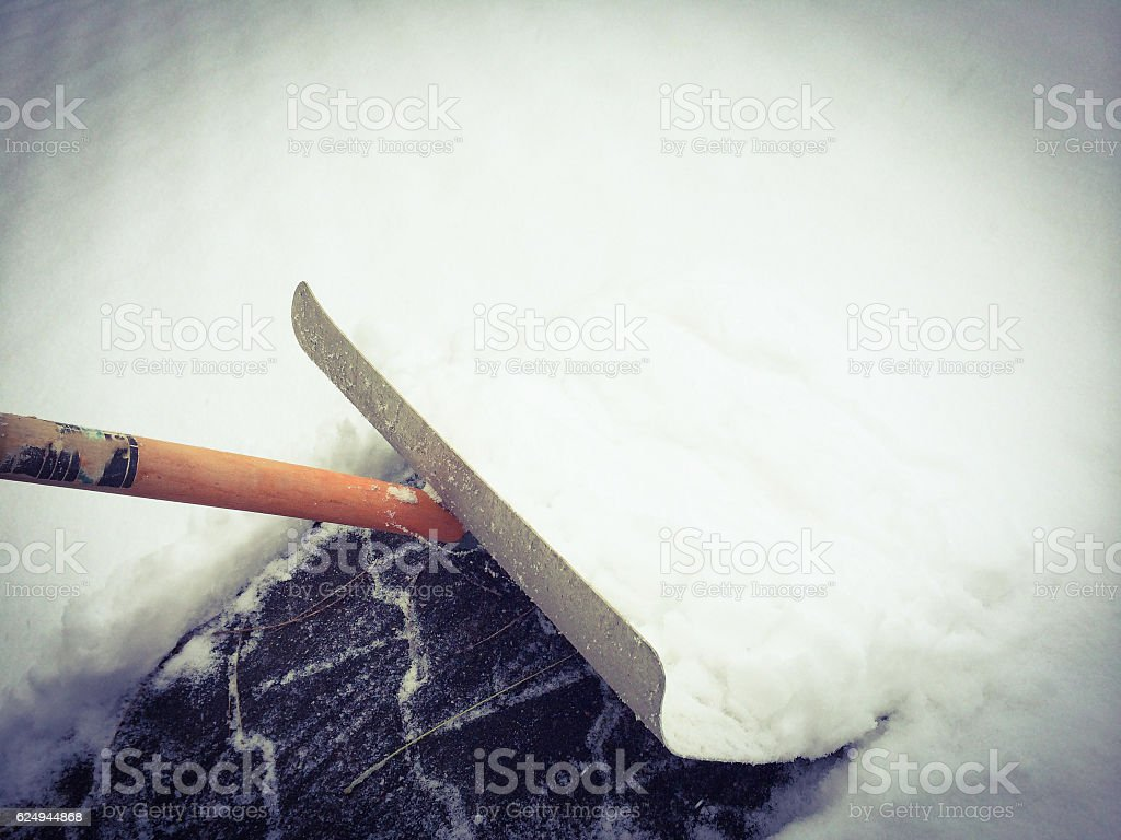 Man working with snow shovel stock photo