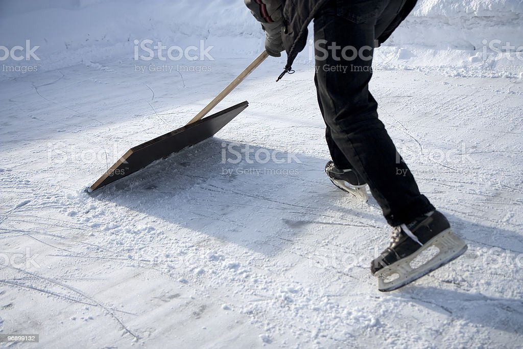Man working with snow shovel royalty-free stock photo