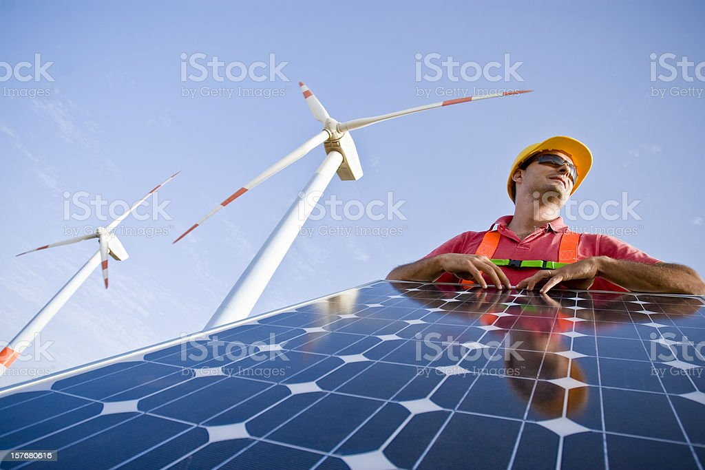 A man working with solar panels stock photo