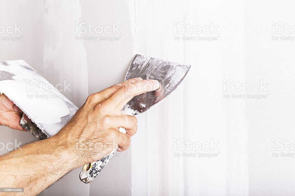 Man working with spatula stock photo