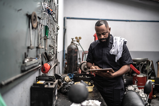 Car mechanics, workers, customers, satisfaction / Auto car repair service center.