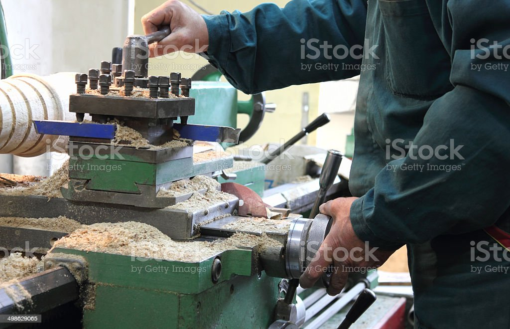Man works in a lathe stock photo