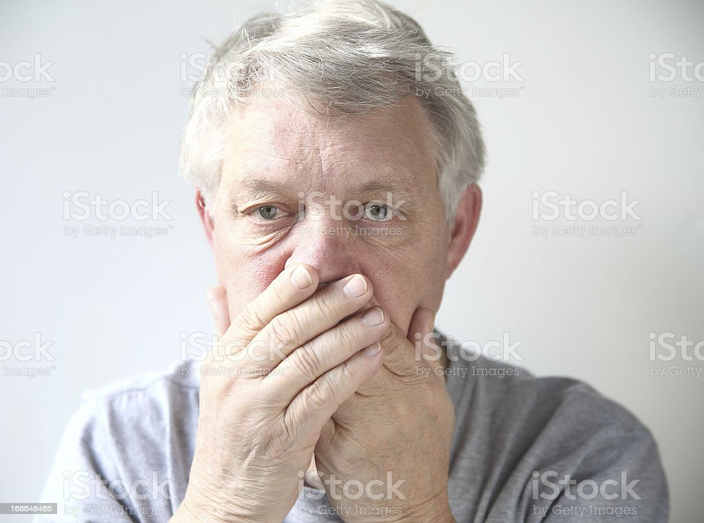 man worried about his bad breath stock photo