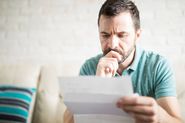 Man worried about his monthly payments stock photo